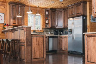 Overview of kitchen Cabinet in birch in a dark stain and pine walls and ceiling