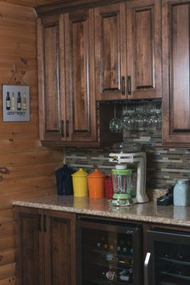Solid Birch bar area cabinets in a dark stain