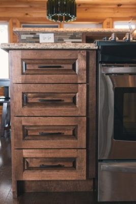 Detail of drawers in solid birch stained dark brown