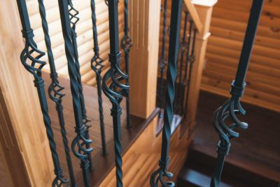 Wrought iron spindles with cages shown on pine stair case