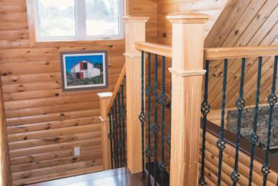 Solid Pine Post and Rail with wrought iron spindles pine log siding on walls
