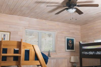 Guest room with white wash pine paneling on ceiling and walls