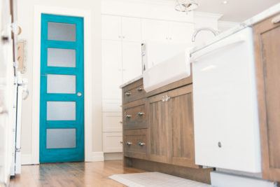 5 Panel Shaker Door in Turquoise with rain glass shown with stained kitchen island