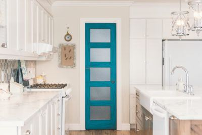 5 Panel Shaker Door in Turquoise with rain glass shown in white kitchen