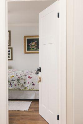 Craftsman door opening into guest room showing MDF casing