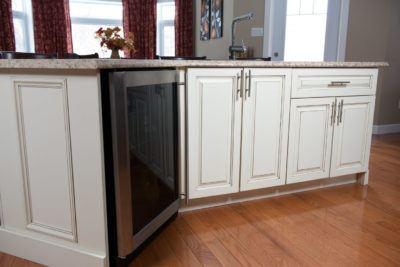 White angled kitchen island in antique finish