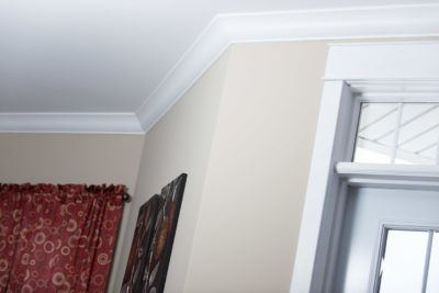 Large ogee ceiling crown shown with plain header and casing over a exterior door