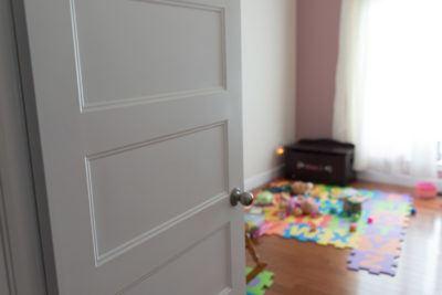 5 panel Conmore door opening up to playroom