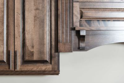Detail of Custom decorative wood range hood in stained birch