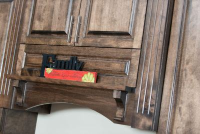Custom decorative wood range hood in stained birch