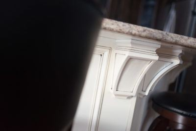 Detail of glazed decorative island corbels and panels