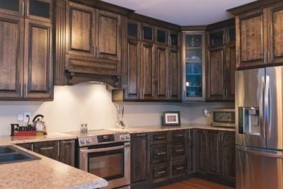 Overview of birch cabinets in a dark stain