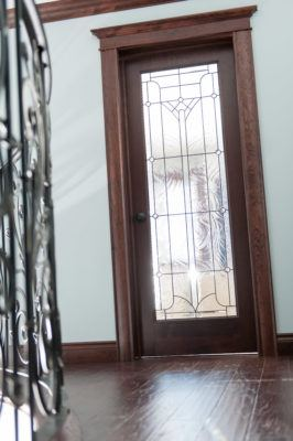 Designer french door in cherry with Solid cherry baseboard, crown, casing and headers stained mahogany