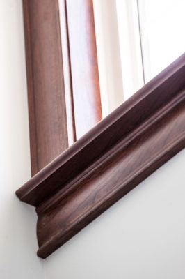 Solid cherry sills and casing stained mahogany