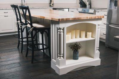 White Custom kitchen island with open shelf, turned posts and solid birch butcher block top