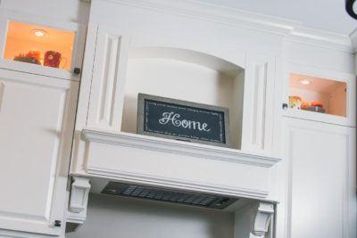 White Decorative Range hood with corbels and shelf