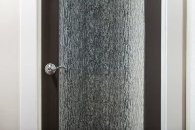 Detail of Rain Glass Door with lever knob and plain casing