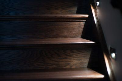 Detail of Oak Stairs in a dark stain shown with custom lighting