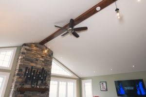 custom wood beam on vaulted ceiling