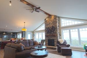 Overview of living room with vaulted ceiling and custom wood beam