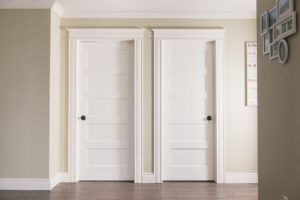 5 panel conmore doors with casing, baseboard, crown and headers
