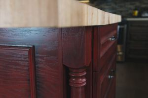 Detail of turned post on red kitchen island