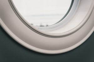 Detail of arched casing around round window