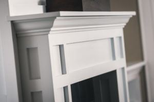 Custom Mantel in white with recessed panel and crown moulding